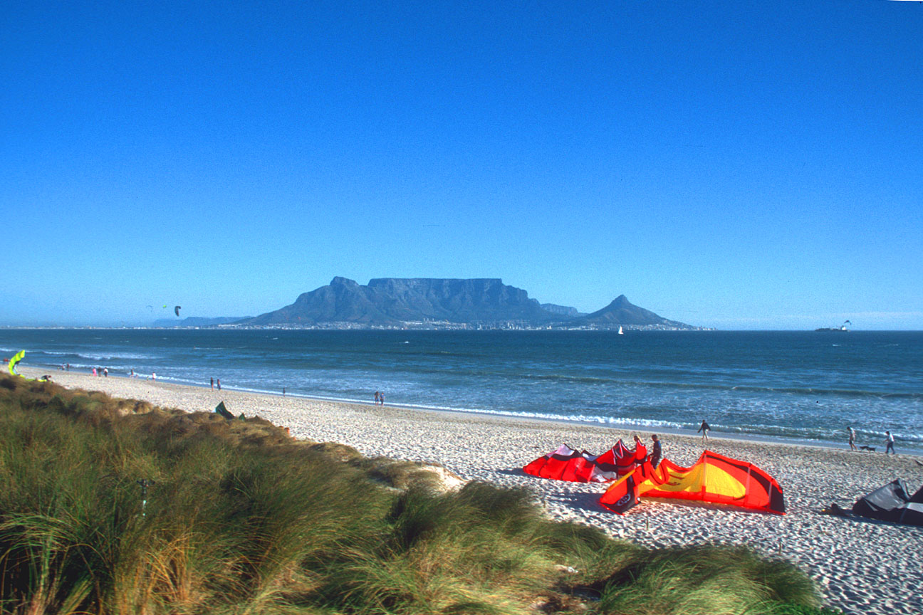 CPT Bloubergstrand beach with Table Mountain and kite surfers b