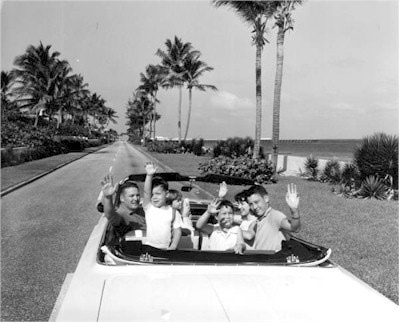 driving tourist family